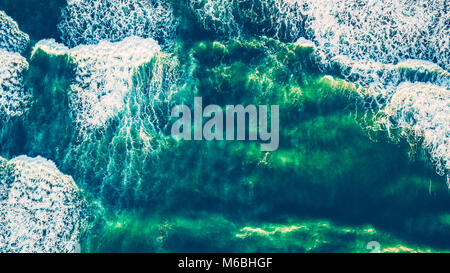 Bird's eye view on the open waters of planet earth, stormy seas, blue turquoise water of an ocean with waves and - Stock Photo