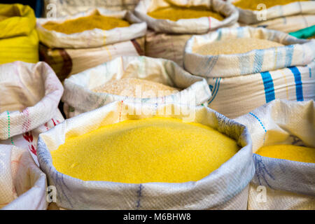 Sacks of grains and flours at a stall in the Old Medina souks in Fes, Morocco - Stock Photo