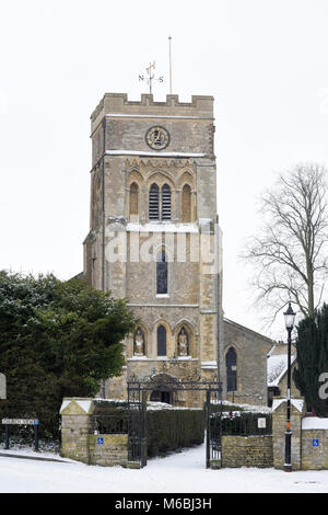 Saint Peter's Church, Brackley, in the snow. - Stock Photo