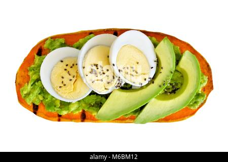 Sweet potato toast with avocado, eggs and chia seeds. Isolated on a white background. - Stock Photo