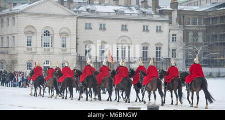 1 March 2018. Life Guards ride through wind blown snow to attend Changing the Guard ceremony at Horse Guards Parade, - Stock Photo