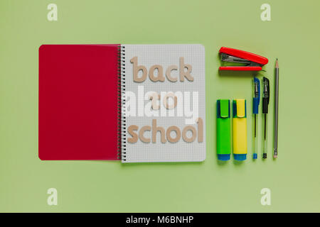 Back to school still life concept with green color background. - Stock Photo