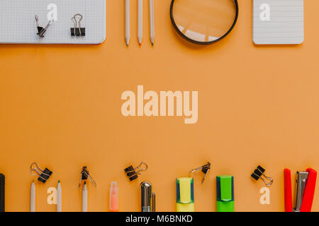 Back to school with copy space concept, in orange color background. - Stock Photo