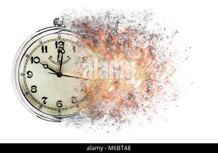 Time is running out concept shows clock that is dissolving away into little particles. - Stock Photo