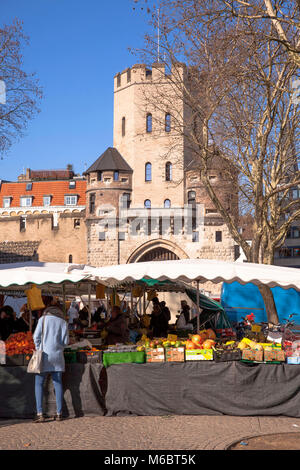 Germany, Cologne, market in front of the historic town gate Severinstorburg at the Chlodwig square in the south - Stock Photo
