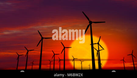 Energy windmills silhouette on sunset background. Concept of ecological power. - Stock Photo
