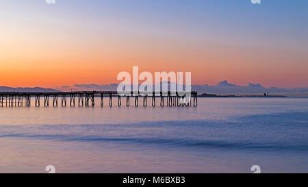 Beach pier at sunrise at Ventura Pier - Stock Photo