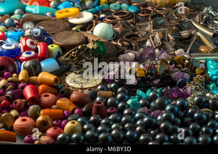 Pile of bead, buttons, black pearls and decorative accessories - Stock Photo