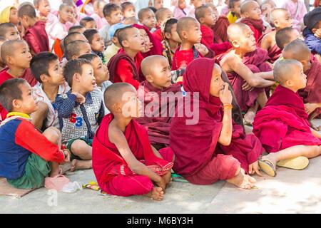 children's faces watching television at Aung Myae Oo Monastic Free Education School, Sagaing, Mandalay, Myanmar - Stock Photo