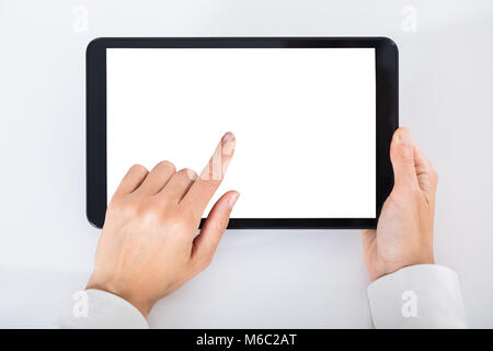 High Angle View Of A Businessperson Using Digital Tablet With Blank White Screen - Stock Photo
