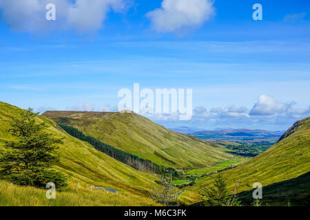The road through Glengesh pass in County Donegal is tricky at best with its tight turns down to the valley. - Stock Photo