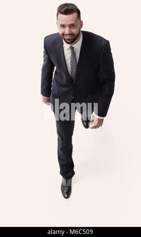 confident businessman goes forward - Stock Photo