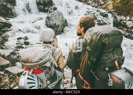Couple backpackers hiking in mountains together love and Travel adventure Lifestyle wanderlust concept active vacations outdoor Stock Photo