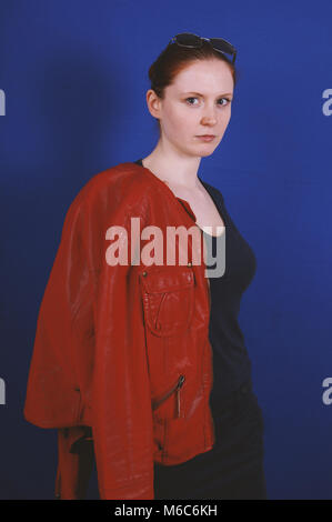 young woman posing in vintage fashion red leather jacket - Stock Photo