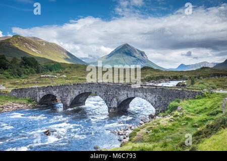 View of Sligachen Old Bridge over River Sligachan, Isle Of Skye - Stock Photo