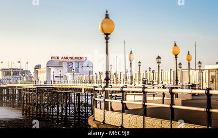 Worthing Pier from Marine Parade - popular in the summer as a traditional seaside attraction including amusements - Stock Photo