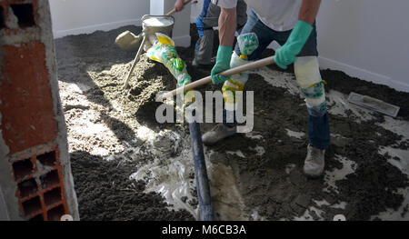 picture of a concreting the floor of a new house - Stock Photo