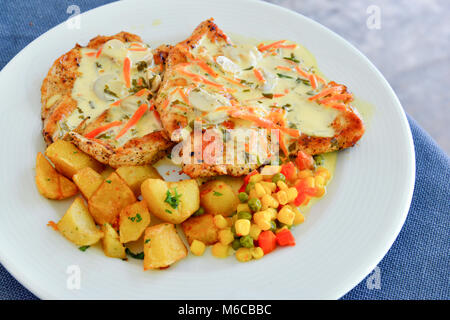 Picture of a Grilled garnish chicken steaks - Stock Photo