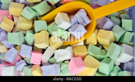 Nice sweet jelly candies in three colors that are exposed to be sold. - Stock Photo