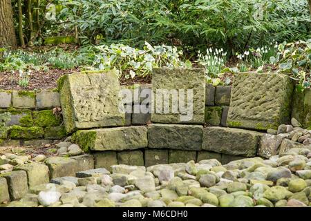 Stone garden seating at York Gate Garden Leeds - Stock Photo