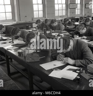 1950s, historical picture, a group of young adult students doing a geometry class at a technical college, England, - Stock Photo