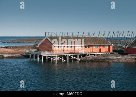 Norwegian landscape, traditional red wooden houses on rocky islands. Ringholmen, Norway - Stock Photo