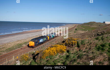 2 Direct rail Services class 37 locomotives pass Seascale shortly after departing from Sellafield with a Sellafield - Stock Photo