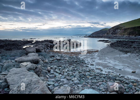 Dusk over the beach at Portwrinkle on the south coast of Cornwall - Stock Photo