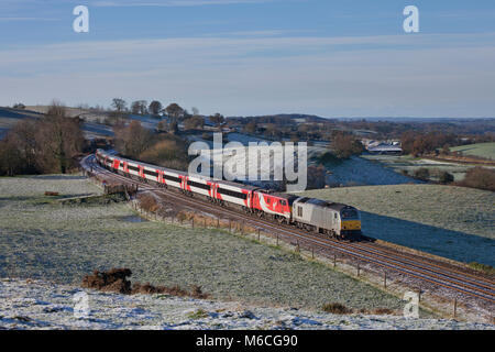 A Virgin Trains East Coast electric inter city 225 being hauled by a diesel locomotive at Upper Denton, east of - Stock Photo