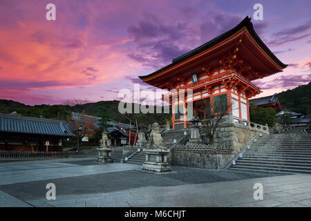 Nio-mon gate of Kiyomizu-dera Buddhist temple in beautiful sunrise morning scenery with dramatic red sky, Higashiyama, - Stock Photo