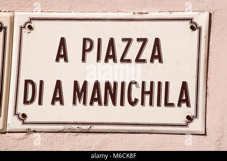 Corsica: sign of one of the main square in the alleys of Bonifacio, city at the southern tip of the island built - Stock Photo