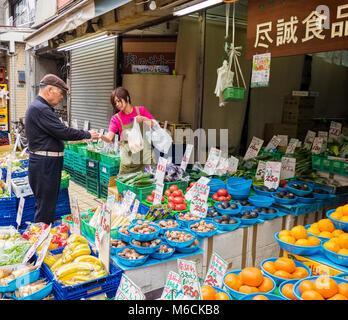 Market stall selling street food in Yanaka Ginza, Yanaka's main shopping street in Tokyo, Japan - Stock Photo