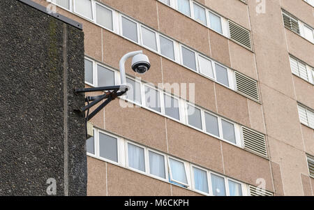 CCTV security Camera mounted on the wall of a high rise tower block in Wolverhampton, West Midlands, UK - Stock Photo