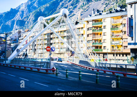 The Gran Valira is the biggest river in Andorra flowing under the Pont de Paris in Andorra la Vella during the winter. - Stock Photo