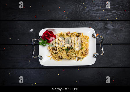 Asian noodles funchoza with seafood and spicy fish sauce - Stock Photo