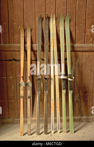 Vintage wooden ski`s standing against a wooden wal - Stock Photo