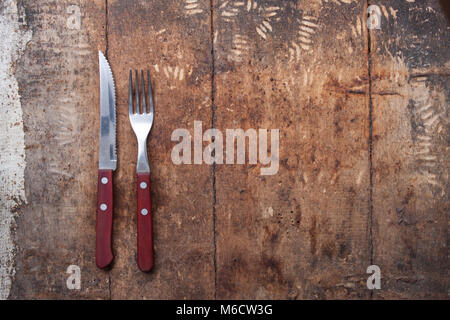 knife and fork on wooden background. Cutlery on wooden.. - Stock Photo