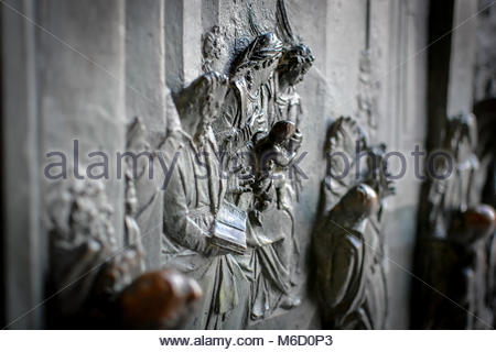 Close up of the Bronze relief sculpture of the virgin Mary by Bonanno da Pisa on the front of the Duomo cathedral - Stock Photo