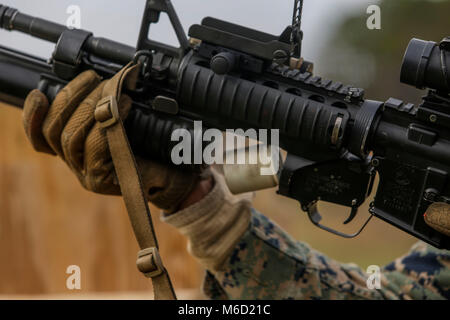 A 40mm practice round casing ejects out of an M203 grenade launcher during a grenade launcher range hosted by Marines - Stock Photo