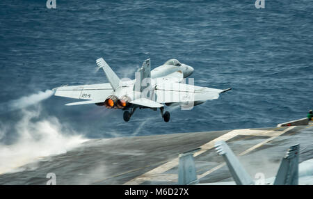 """180227-N-WE240-0072  SOUTH CHINA SEA (Feb. 27, 2018) An F/A-18E Super Hornet assigned to the """"Kestrels"""" of Strike - Stock Photo"""