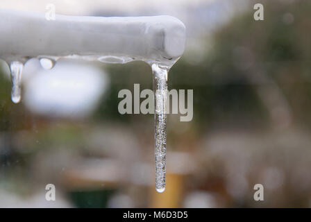 Portland, Dorset. 2nd March 2018 - Freezing rain hit Fortuneswell, Isle of Portland, overnight. where Icicles formed - Stock Photo