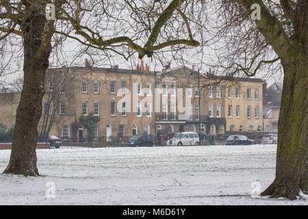 Windsor, UK. 2nd Mar, 2018. A view across a snow-covered Windsor Great Park towards a terrace of 1830s townhouses. - Stock Photo