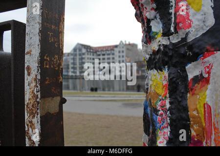 graffiti detail of berlin wall, east side gallery murales - Stock Photo