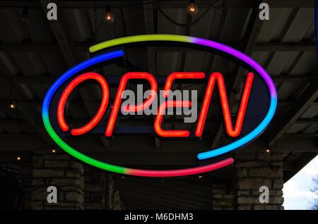 Neon open sign in front of a business - Stock Photo