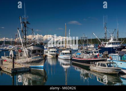 Fishing boats at Municipal Wharf marina near ferry terminal in Port McNeill, North Vancouver Island, British Columbia, - Stock Photo