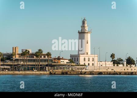 Malaga, Spain - December 7, 2016: Port view and tower lighthouse (La Farola de Malaga) in Malaga, Andalusia, Spain. - Stock Photo
