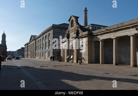 Plymouth Devon England UK  Historic buildings line a paved road at Royal William Yard in Plymouth. February 2018. - Stock Photo