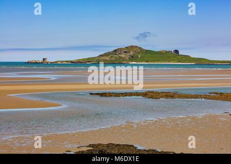 Ireland's Eye is an island on the East coast of Ireland near Howth as seen from Burrow Beach of Sutton, Dublin - Stock Photo