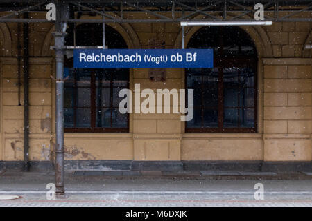 Reichenbach, Germany - March 3, 2018: View of a platform in the Reichenbach railway station near snow fall, Thuringia, - Stock Photo