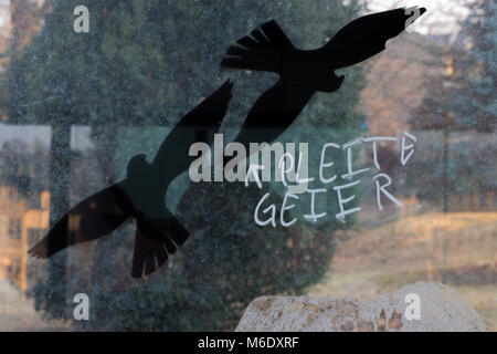 Mylau, Germany - March 2,2018: Symbol picture for bankruptcy or lack of money. Two birds with the writing 'Bankrupt - Stock Photo